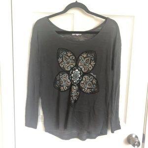 Long sleeve shirt with a flower design